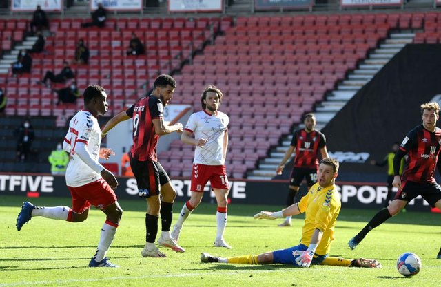 Dominic Solanke of AFC Bournemouth scores his side's third goal past Marcus Bettinelli of Middlesbrough.