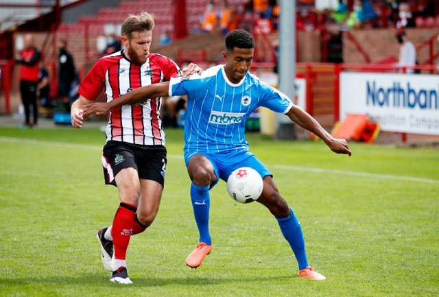 Danny Elliott of Chester in action with Andrew White of Altrincham during the Vanarama National League North Play-Off match between Altrincham and Chester at  on July 19, 2020 in Altrincham, England. (Photo by Clive Brunskill/Getty Images)